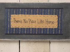 THERES NO PLACE Like Home wood wall plaque / primitive rustic folk art style wood plaque / happiness sign. $17.95, via Etsy.
