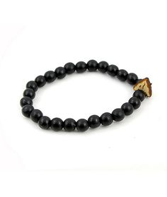 Accent any outfit with the style of the Arrow Head Black bracelet from Goodwood NYC. This bracelet is made with Black wooden beads and a stretchy band for a secure and easy wear, while the small arrow head charm with a Goodwood logo sets off your personal
