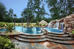 Bossier City Pool Design, Shreveport Pool Construction - natural-grotto-boulder-waterfall-tanning-ledge-stone-Deck-stone-planter-turtle-bay-pebble-sheen-grand-effects-fire-bowl-multi-level-LED-lights