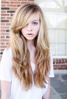 Side Part. Long bangs. Gonna do this. I kind of dig the color as well. long layered hair style with bangs