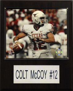 "Colt McCoy is celebrated on a 12"" X 15"" cherry wood plaque featuring a licensed 8X10 photo, one genuine licensed trading card of the player along with an engraved nameplate.   Superior, high-clarity acrylic lens covers firmly affixed to the plaque with brass-type screws protect both the photo and trading card.  The polished look makes for a well-crafted, long-lasting piece perfect for displaying in an office, recreation room, or any spot for a fan to enjoy.  It is proudly produced and…"