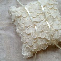This ring pillow covered with sampaguita-inspired lace is also perfect for a Filipiniana wedding. | 19 Beautiful Ways To Use Sampaguita Flowers In Your Wedding