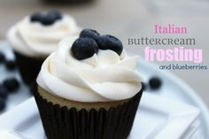 Blueberries and Italian Buttercream Frosting fill and top these moist vanilla cupcakes.