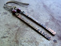 Hand-forged copper birch bark twigs are accented by tiny Czech glass beads in these forest-inspired earrings.