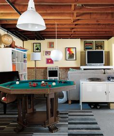 Make a room multipurpose by creating zones like this family's basement with space for dad and an area for the kids.
