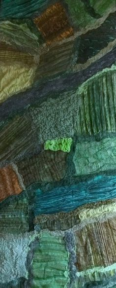 'View from the blue' map art quilt by Mary Macintosh. A view of the countryside from a plane window.