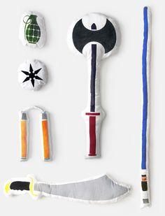 Pillow Fight! Light sabers, scimitars, double sided viking axes, nunchucks, ninja stars and grenades. Silkscreen on fabric. By Bryan Ku
