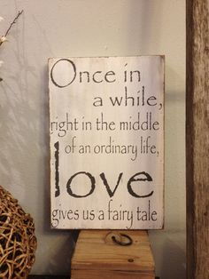 Once in a while, right in the middle of an ordinary life Love gives us a fairy tale - handpainted wood sign - great wedding gift. $38.00, via Etsy.