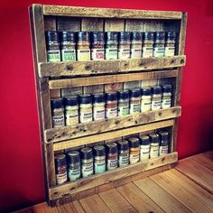 Spice rack made with pallet; would be great to hold bottles of paint