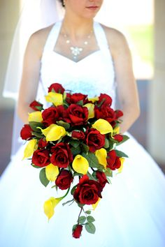 Red roses and yellow cala lilies