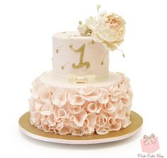 First Birthday Ruffle Inspired Cake with blush pink flowers and gold embellishments.  Flowers include peonies and garden roses.  Happy Birthday Sidra!