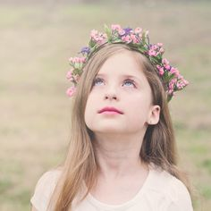 Learn how to make a floral crown with this simple tutorial. These little crowns are perfect for weddings, Spring photo sessions or dress up.