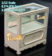A very beautiful display case for dollhouse decoration:    * Scale: 1/12,  * Material: cherry wood, han