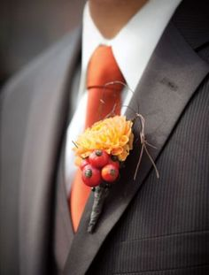 Berry and Dahlia Boutonniere love the orange ties or orange shirts...fyi, have the guys buy matching suits - so much better than renting!