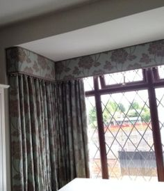 Curtains and pelmet in a square bay