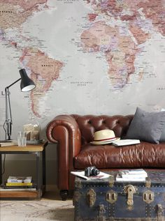 world map wallpaper - subtle colours  - reading nook - leather couch
