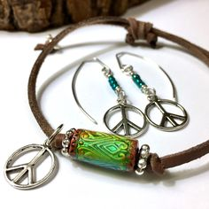 """☮️ Show your passion for PEACE with these fun, retro 1960s-style pieces!  •Adjustable bracelet with color-changing """"MOOD"""" bead &/or earrings in antique silver or brass  •Faux leather - no animals were harmed!  •Includes """"5 Facts About the Peace Sign."""""""