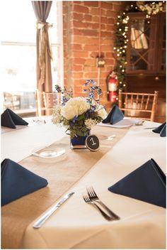 simple rustic navy and white wedding centerpieces / wedding flower decor design