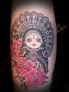 Matryoshka tattoo that resembles the style of art I like. Would not mind getting this.