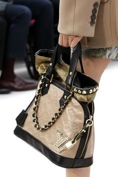 Louis Vuitton - I'm not usually all about high end bags n shit but I like this one
