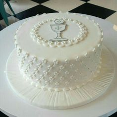Hayden - This cake is a symbol of the eucharist or first communion and is perfect for a themed party. The white color of the cake and the bread and wine logo are all symbols of the eucharist. It also happens to look magnificently scrumptious. Comunion Cakes, First Holy Communion Cake, First Communion Decorations, Religious Cakes, Confirmation Cakes, Occasion Cakes, Girl Cakes, Love Cake, Celebration Cakes