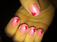 Pink nails with hearts.