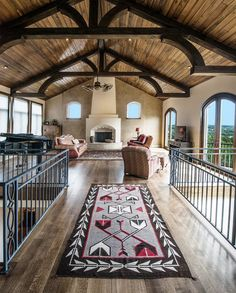 Southwestern Design in a modern log home. Love the long hall and all the windows.