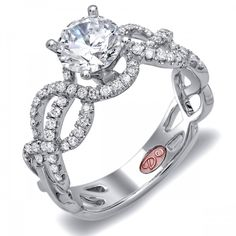 DemarcoJewelry.com  Available in White Gold 18KT and Platinum. 0.35 RDCapture her grace and endless beauty with this confident yet elegant design. We have also incorporated a unique pink diamond with every single one of our rings, symbolizing that hidden, unspoken emotion and feeling one carries in their heart about their significant other. This is not just another ring, this is a heirloom piece of jewelry.   Demarco Bridal Engagement Ring.