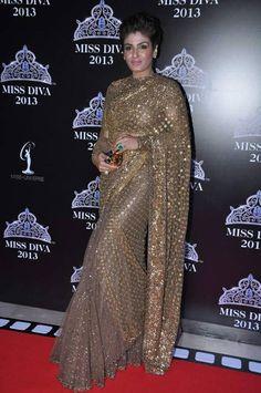 Raveena Tandon in Heavy Gold #Embroidered #Saree by Sabyasachi.