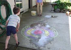 Frugal Family Fun, all you need is chalk and some filled water balloon for this activity.