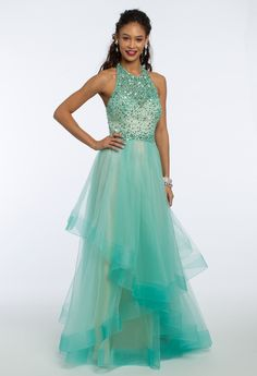 Make your mark in a trendy tiered style! This ball gown prom dress features an illusion beaded halter neckline, a fitted bodice with a beaded waistband, ball gown skirt and open back. Have all eyes on you at prom when you pair this pick with metallic heels, teardrop earrings and a metal cage over glitter bag. #CamilleLaVie