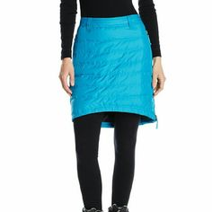 Skhoop Down Winter Skirt This Skhoop Down Skirt combines sportiness and warmth in all the right ways. Slightly longer in the back, perfect over other layers in the winter, or tights. Two way side zippper on one side and one way zipper on lower left side to allow for freedom of movement. It also has zipper pockets! 80/20 down/feather/500 fill.  Only worn a couple times. Looks awesome over leggings and/or skinny jeans too! Skhoop Skirts