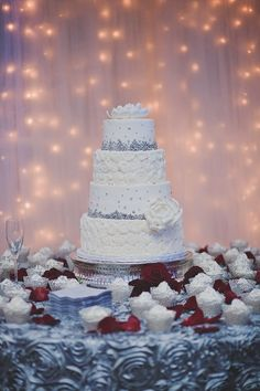 White and silver tiered cake with silver non perils at Callie and Spencer's Coca-Cola Themed Wedding at Georiga Rustic Wedding Venue - Fritz Farm. Jaime Warren Photography