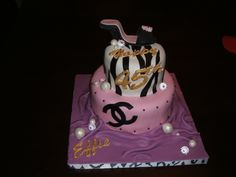 Two tier black white and pink fondant zebra print with bottom tier chanel logo, rustic gold chocolate writing, fondant pearls and a gumpaste shoe as a topper