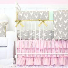 We loved our deer head fabric so much we had to make it girly! What more can you ask for in a crib set then ruffles, deer heads, gold, and mint. This is perfect for a little girls baby nursery!