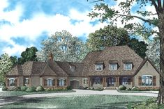 The Plan Collection: Front Elevation of French Country House # 153-1942