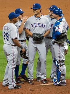 Texas Rangers starting pitcher Yu Darvish is greeted by his teammates as he leaves the game after surrendering a hit in the bottom of the ninth inning...
