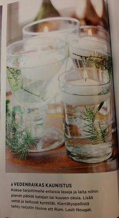 Kattaus: laseihin katajan tai kuusen oksat, vettä ja kelluvat kynttilät