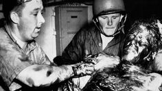 World War II in Pictures. A survivor of the USS Indianapolis.