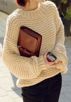 Right angled shot of girl in khaki knit bishop sleeve sweater