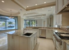 Aquilane Shores - Gourmet kitchen with view of Naples Bay - center island, vegetable sink, Wolf range. Naples, Florida