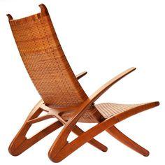the Dolphin Chair by Hans Wegner | An oak and cane Dolphin folding lounge chair. Design by Hans Wegner, Cabinetmaker Johannes Hansen.