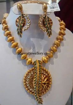 Jewellery Designs: Gold Balls Necklace with Leafy Pendant