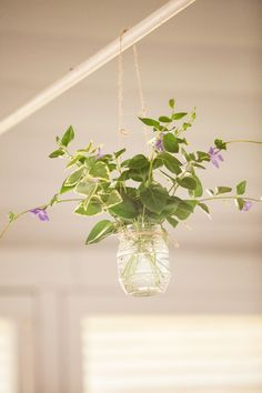 wild flowers hanging gently from a beam inside the reception hall