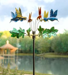 Hummingbird Metal Wind Spinner features 6 colorful hummers. Stands at 7' tall.