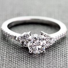 0.60 Carat Round G VS1 Set in a Diamond Engagement Ring with Side Accents in White Gold