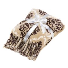 Gorgeous to look at, gorgeous to wrap up with! This beautiful taupe and brown blanket features an all-over Baroque pattern that's finished off with fanciful tassels. Cuddle up and enjoy!