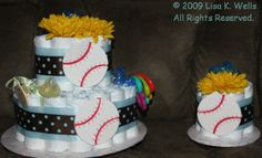 Two-tier and mini diaper cake set, boy theme.  See http://www.lisasgiftcakes.com for more info or to order!