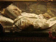 St. Anna Maria Gesualda Antonia Taigi (b. 29 May 1769 - d. 9 June 1837) was an Italian woman who was beatified by Pope Benedict XV in 1920. In Trastevere, San Crisogono, I was able to see the incorrupt body of St. Anna Maria Taigi. She was a little bity thing but what a heart! It was wonderful seeing her incorrupt body...like meeting an old friend in a strange city. She looked like she would just about sit up and talk...Patron Saint of mothers & housewives & victims of spousal abuse. YBH