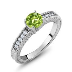"1.10 Ct Round Green Peridot White Topaz 925 Sterling Silver Engagement Ring. ELEGANT- And sophisticated this gorgeous ring promises a carefree and comfortable wear. It's design is meant to accentuate the fingers beautifully. PURE PERFECTION- This ring is perfect for professing your affections for that special someone or as a just ""Thinking of you"" gift. It can be worn with any outfit and is a truly gorgeous addition to any jewelry collection. MESMERIZING DESIGN - This design is Sleek and..."